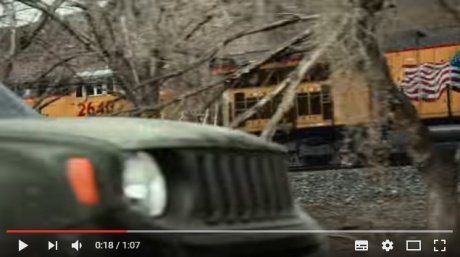The very first look at an actual Jeep, more than a quarter into the advertisement, and it's right next to a God damn American flag.